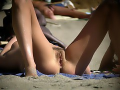 Unshaved nudist's pussies on beach
